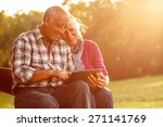senior couple sitting on a park ... | Shutterstock . vector #271141769