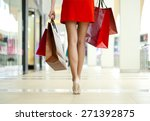 legs of shopaholic wearing red... | Shutterstock . vector #271392875