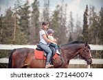 the young woman horseback... | Shutterstock . vector #271440074