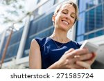 businesswoman with a phone in a ... | Shutterstock . vector #271585724