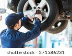 mechanician changing car wheel... | Shutterstock . vector #271586231