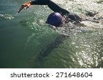 Male swimmer swimming in open water. Athlete practicing for the competition. - stock photo