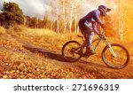 man riding a mountain bike... | Shutterstock . vector #271696319