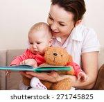 happy mother is reading book... | Shutterstock . vector #271745825