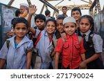 Small photo of MUMBAI, INDIA - 12 JANUARY 2015: Indian children after school in Dharavi slum
