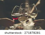 Small photo of Wining with friends Four friends cheering Drinking wine in a restaurant