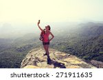 young woman hiker taking photo... | Shutterstock . vector #271911635