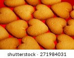 Saint Valentine cookies concept. Creative snack set of freshly baked cookies over red background. Close up. Indoor shot - stock photo