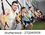 people at gym doing elastic... | Shutterstock . vector #272045939