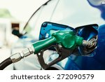petrol pump filling closeup | Shutterstock . vector #272090579