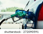 petrol pump filling closeup | Shutterstock . vector #272090591