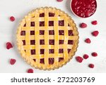 Small photo of Raw rustic american raspberry pie preparation with jam and raspberries on white kitchen table background