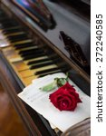 red rose and old piano   Shutterstock . vector #272240585