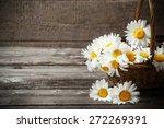 Flowers In Basket On Wooden...