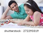 little girl drawing while lying ... | Shutterstock . vector #272293319