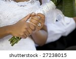 An African-American bride holding her bouquet after the wedding ceremony - stock photo