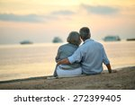 Happy Mature Couple Relaxing O...