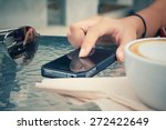 latte coffee with smart phone | Shutterstock . vector #272422649