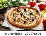 fresh tasty pizza on brown... | Shutterstock . vector #272476601