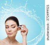 beautiful young woman applying...   Shutterstock . vector #272499521