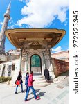 Small photo of ISTANBUL, TURKEY - APRIL 10, 2015: Almshouse door of Hagia Sophia with unidentified people. Hagia Sophia Almshouse was a charity built by Sultan Mahmud I in 1743 for distributing food to poor people