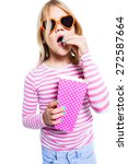 girl eating pop corn out of a... | Shutterstock . vector #272587664