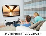 couple together watching film... | Shutterstock . vector #272629259