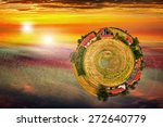 Abstract view of old farm surrounded by sunset sky. - stock photo