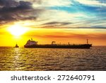 Tugboat Pulling The Tanker At...