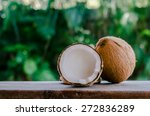whole and broken coconut on the ... | Shutterstock . vector #272836289