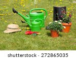 gardening tools and a straw hat ... | Shutterstock . vector #272865035