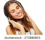 woman with headphones listening ... | Shutterstock . vector #272880851