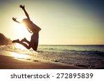 teen girl jumping on the beach... | Shutterstock . vector #272895839