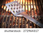 spatula on the hot empty clean... | Shutterstock . vector #272964317