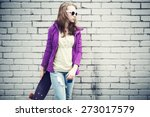 blond teenage girl in jeans and ... | Shutterstock . vector #273017579