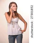 teen girl talking on the phone | Shutterstock . vector #27301852