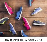 various running shoes laid on a ...   Shutterstock . vector #273083795