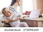 Young Mother In Home Office...