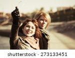 two happy women on a city street   Shutterstock . vector #273133451