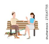 Man And Woman Sitting On Bench...