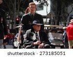 Small photo of BRISBANE, AUSTRALIA - APRIL 25 : Intergenerational support to older veteran during Anzac day centenary commemorations April 25, 2015 in Brisbane, Australia