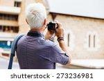 senior man with camera in city | Shutterstock . vector #273236981