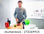 handsome young man cooking at... | Shutterstock . vector #273269915