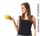 teen girl holding a cup of... | Shutterstock . vector #273282824