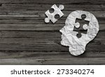 Stock photo mental health symbol puzzle and head brain concept as a human face profile made from crumpled white 273340274