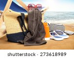 chair on sand and shoes with... | Shutterstock . vector #273618989