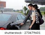 Young Man Opening Door Of Car...