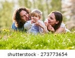 young family together in grass... | Shutterstock . vector #273773654