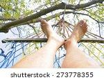 Feet In Hammock On The Beach