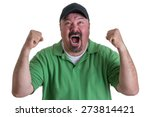 Small photo of Excited Overweight Man Wearing Green Shirt and Black Baseball Cap Celebrating, Pumping Fists and Cheering in Studio with White Background